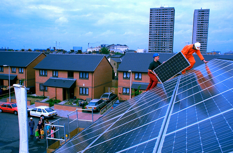 Greenpeace helps to install solar panels on houses in Docklands