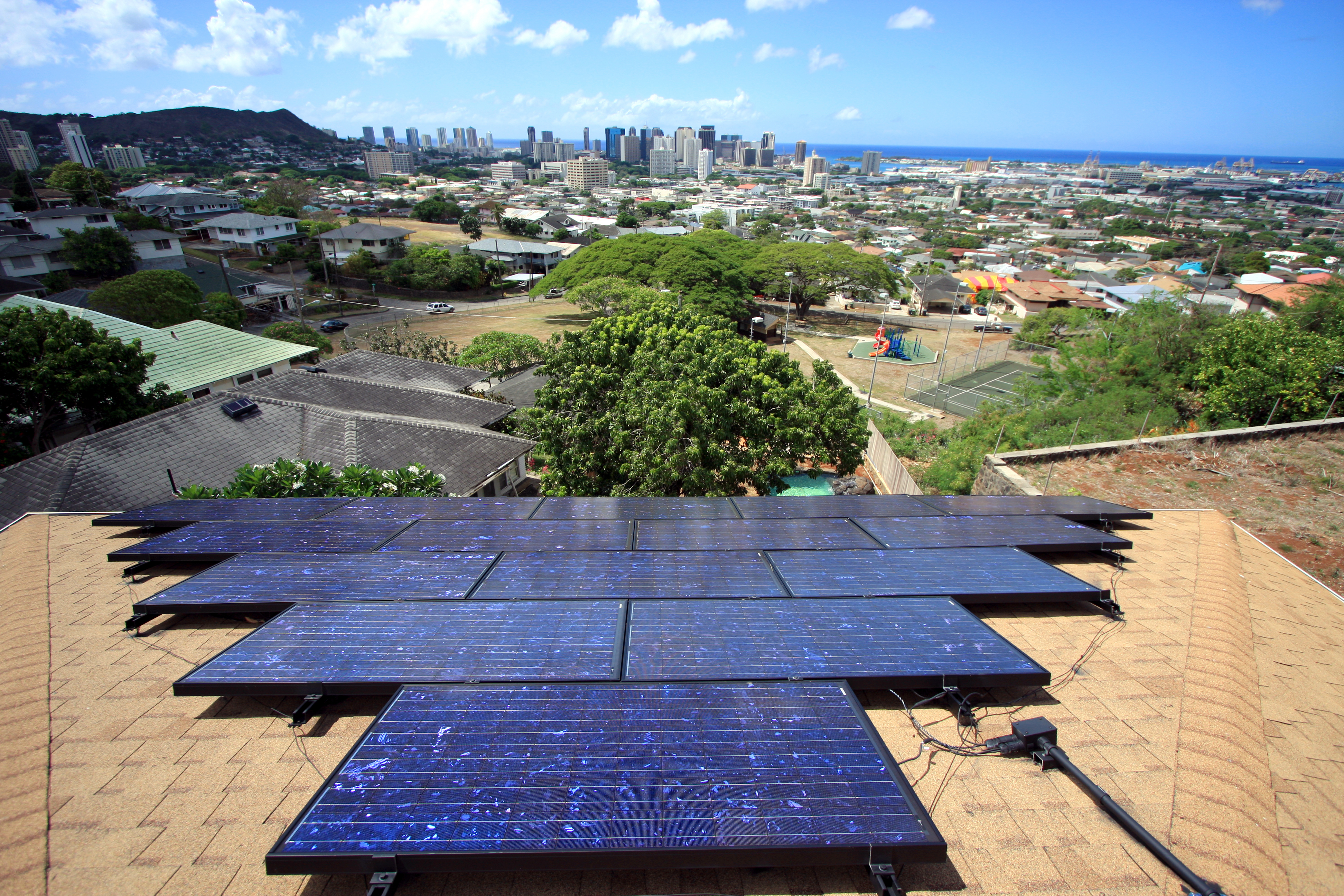 How much is too much? Solar panels on too many rooftops in Honolulu, Hawaii, caused grid safety issues in 2013.